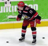 Matt Caito crouches near the boards during pre-game warmups before a Grand Rapids Griffins game.