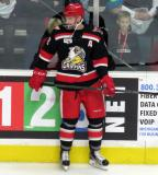 Brian Lashoff stands at the boards during pre-game warmups before a Grand Rapids Griffins game.