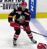 Dominic Turgeon skates near the blue line during pre-game warmups before a Grand Rapids Griffins game.
