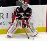 Cal Heeter crouches at the boards during pre-game warmups before a Grand Rapids Griffins game.