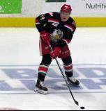 Conor Allen skates with a puck during pre-game warmups before a Grand Rapids Griffins game.
