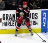 Dominic Turgeon plays with a puck during pre-game warmups before a Grand Rapids Griffins game.