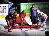 "Nathan Paetsch takes a ceremonial faceoff against Mark McNeill of the Rockford Ice Hogs at the start of the Grand Rapids Griffins' ""Superhero Night"" game."