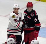 Brian Lashoff and Rockford's Ville Pokka come together during a scrum between the Grand Rapids Griffins and Rockford IceHogs.