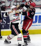 Louis-Marc Aubry fights Sam Carrick of the Rockford IceHogs during a Grand Rapids Griffins game.