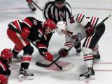Ben Street takes a faceoff against Mark McNeill of the Rockford IceHogs during a Grand Rapids Griffins game.