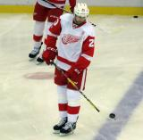 Drew Miller balances a puck on his stick during pre-game warmups.