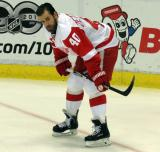 Henrik Zetterberg crouches in the corner during pre-game warmups.