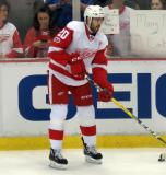 Drew Miller stands near the boards during pre-game warmups.
