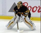 Tuukka Rask of the Boston Bruins crouches near the boards during pre-game warmups before a game against the Detroit Red Wings.