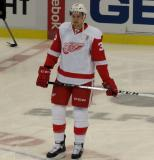Anthony Mantha stands near center ice during pre-game warmups.