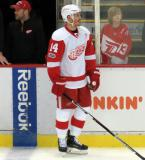Gustav Nyquist stands near the bench during pre-game warmups.
