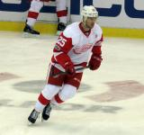 Mike Green skates in the neutral zone during pre-game warmups.