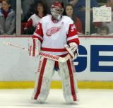 Petr Mrazek stands near the boards during pre-game warmups.