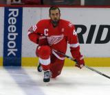 Henrik Zetterberg kneels near the boards during pre-game warmups.