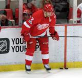 Brendan Smith crouches in the corner during pre-game warmups.