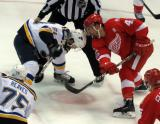 Luke Glendening takes a faceoff against Wade Megan of the St. Louis Blues.
