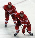 Tomas Tatar and Anthony Mantha get set for a faceoff.