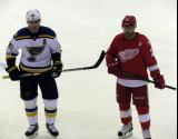 Tomas Tatar gets set for a faceoff opposite Alexander Steen of the St. Louis Blues.