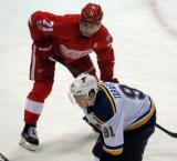 Dylan Larkin lines up at wing for a faceoff opposite Vladimir Tarasenko of the St. Louis Blues.