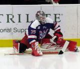 Cal Heeter stretches on the ice during pre-game warmups before the Grand Rapids Griffins' Purple Game.