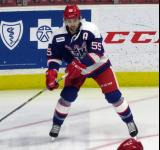 Matthew Ford skates in the corner during pre-game warmups before the Grand Rapids Griffins' Purple Game.
