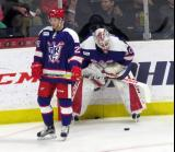 Matt Lorito and Eddie Pasquale stand in the corner during pre-game warmups before the Grand Rapids Griffins' Purple Game.