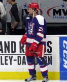 Eric Tangradi stands at the bench during pre-game warmups before the Grand Rapids Griffins' Purple Game.