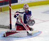Eddie Pasquale knocks aside a puck during pre-game warmups before the Grand Rapids Griffins' Purple Game.