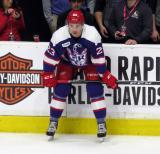 Dominic Turgeon crouches in front of the bench during pre-game warmups before the Grand Rapids Griffins' Purple Game.