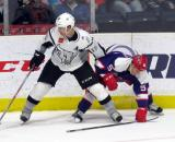 Kyle Criscuolo comes together with Duncan Siemens of the San Antonio Rampage during the Grand Rapids Griffins' Purple Game.
