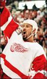 Martin Lapointe raises his arm and hollers in celebration of a Stanley Cup Finals goal.