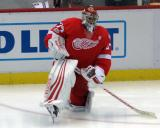 Petr Mrazek stretches near the boards during pre-game warmups before the last game at Joe Louis Arena.