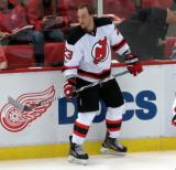 Stefan Noesen of the New Jersey Devils stands at the boards during pre-game warmups before the last game at Joe Louis Arena.