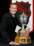 Nicklas Lidstrom holds the Norris Trophy, awarded to him at the 2003 NHL Awards.