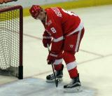 Justin Abdelkader clears pucks out of the net during pre-game warmups before the last game at Joe Louis Arena.
