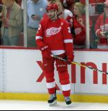 Drew Miller stands at the boards during pre-game warmups before the last game at Joe Louis Arena.