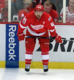 Xavier Ouellet crouches at the boards during pre-game warmups before the last game at Joe Louis Arena.