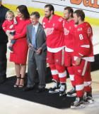 Henrik Zetterberg, alongside wife Emma and son Love, poses for a photo with Red Wings legend Ted Lindsay, Niklas Kronwall, and Justin Abdelkader, during a pre-game ceremony honoring Zetterberg for his 1000th career game.