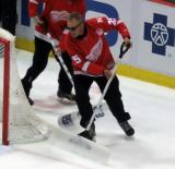 Former Red Wing Darren McCarty helps clear the ice during a stop in play in the last game at Joe Louis Arena.