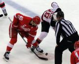 Henrik Zetterberg takes a faceoff against Travis Zajac of the New Jersey Devils during the last game at Joe Louis Arena.