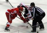 Henrik Zetterberg takes a faceoff against Joseph Blandisi of the New Jersey Devils during the last game at Joe Louis Arena.