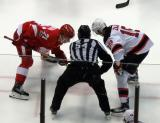 Dylan Larkin lines up for a faceoff against Travis Zajac of the New Jersey Devils during the last game at Joe Louis Arena.