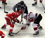 Henrik Zetterberg takes a faceoff against Stefan Noesen of the New Jersey Devils during the last game at Joe Louis Arena.