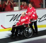 Doug Brown pushes Vladimir Konstantinov's wheelchair during the ceremony following the final game at Joe Louis Arena.