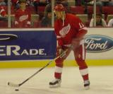 Mathieu Dandenault tees up a shot from the top of the circle during pregame warmups before a preseason game.