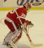 Dominik Hasek makes a save with the puck bouncing off his chest during pregame warmups before a preseason game.