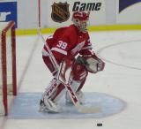 Dominik Hasek readies himself in goal during pregame warmups before a preseason game.