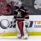 Eddie Pasquale skates near the boards during pre-game warmups before a Grand Rapids Griffins playoff game.