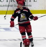 Dan Renouf skates in the neutral zone during pre-game warmups before a Grand Rapids Griffins playoff game.
